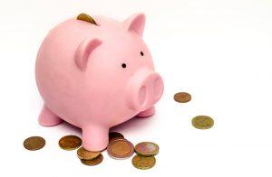 En spargris med pengar för underhållsfonden